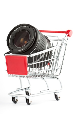 Photo Lens in Shoping Cart on the white photo