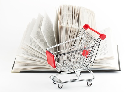 Shopping for Books. Shopping Cart with books on the white background photo