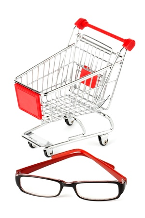 Shopping Cart with eye glasses on the white background photo
