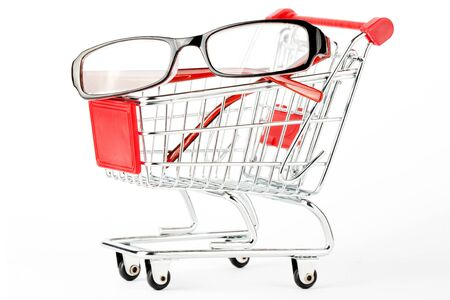 Shopping Cart with eye glasses on the white background Stock Photo