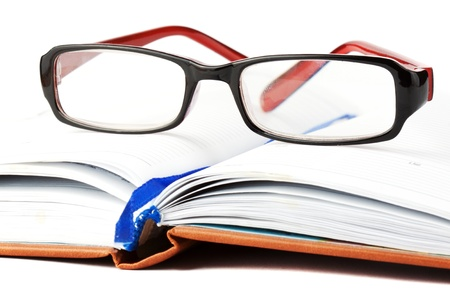 Study. Open Book with eyeglass on the white background Stock Photo - 11795336