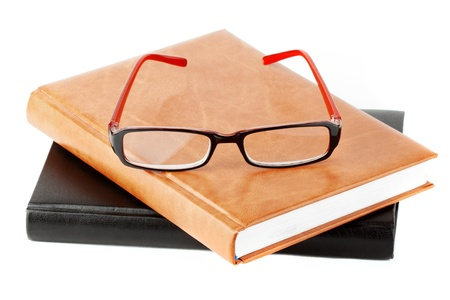 Study. Books stack with eyeglass on the white background Stock Photo - 11795366