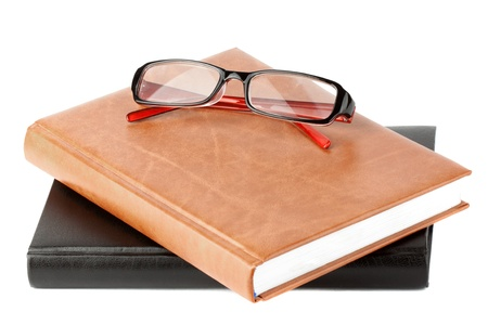 Study. Books stack with eyeglass on the white background Stock Photo - 11795335