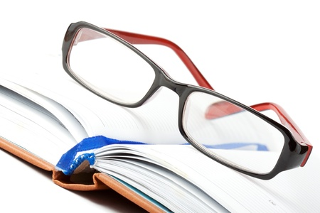 Study. Open Book with eyeglass on the white background Stock Photo - 11795326