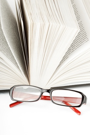 Study. Open Book with eyeglass on the white background Stock Photo - 11795367