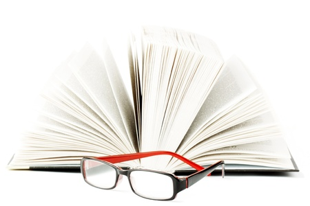 Study. Book with eyeglass on the white background Stock Photo - 11795200