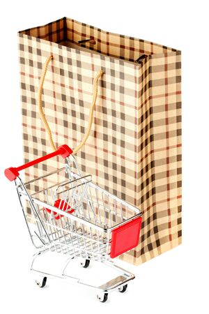 Shopping cart with paper bag on the white background photo
