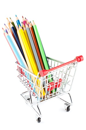 Shopping cart with many pencils on the white background photo