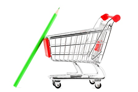 Shopping cart with many pencil on the white background photo