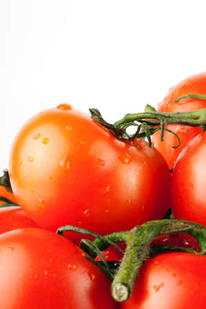 Stack of perfect red tomatos extreme closeup Stock Photo - 11795370