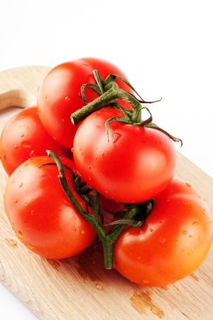 Stack of perfect red tomatos extreme closeup Stock Photo - 11795379