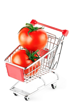 Perfect tomatos in shopping cart on the white background Stock Photo - 11795329