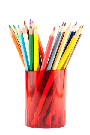 Many pencils in red cup on the white background closeup photo