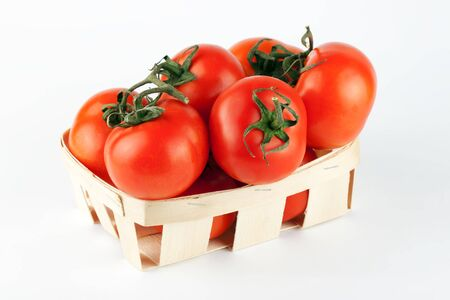bushel: Tomatoes in the wooden basket on the white background