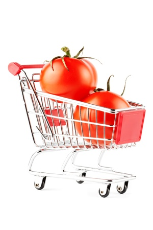 Perfect tomatos in shopping cart on the white background photo