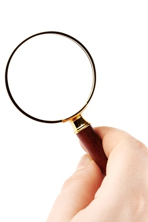 Closeup Magnifying Glass with hand on the white background