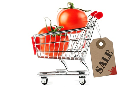 Perfect tomatoes in shopping cart with sale tag on the white background Stock Photo - 11930732