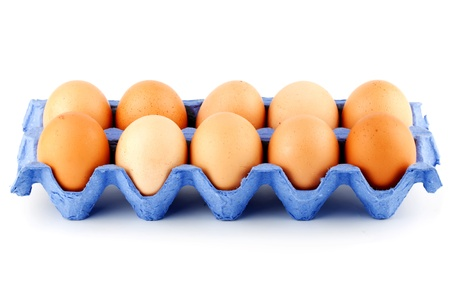 Eggs in carton box on the white background photo