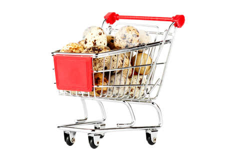 Shopping Cart with Quail Eggs on the white background Stock Photo - 12019724