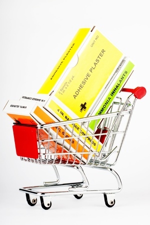 emergency cart: Shopping cart with first aid kit on the white background