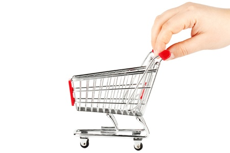 Steel Shopping Cart with hand on the white background photo