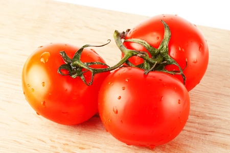 Stack of perfect red tomatos extreme closeup Stock Photo - 12019722