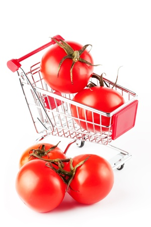 Perfect tomatoes in shopping cart on the white background Stock Photo - 12019716