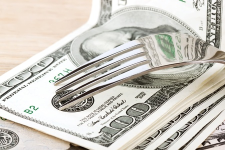 Fork and dollars on the wood table Stock Photo - 12043341