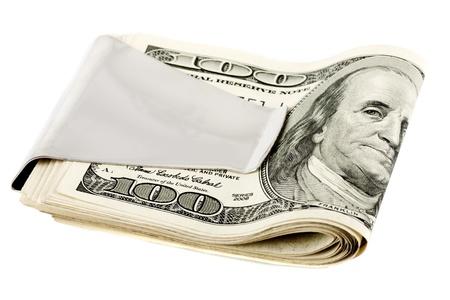 Pengar i sedelklämma på den vita bakgrunden Stockfoto