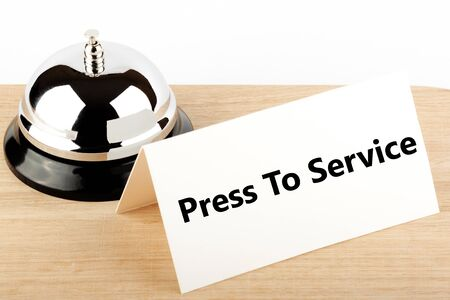 Service Bell with Service Sign at Hotel Desk Stock Photo - 12043366