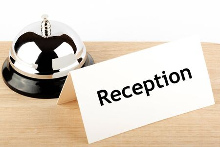 Service Bell with Reception Sign at Hotel Desk Stock Photo - 12043365