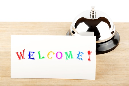 Service Bell with Welcome Sign at Hotel Desk Stock Photo - 12043387