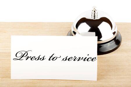 Tjänsten Bell med Service Sign at Hotel Desk