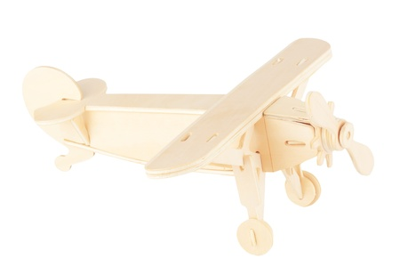 Wooden model of the airplane on a white background Stock Photo - 12154506