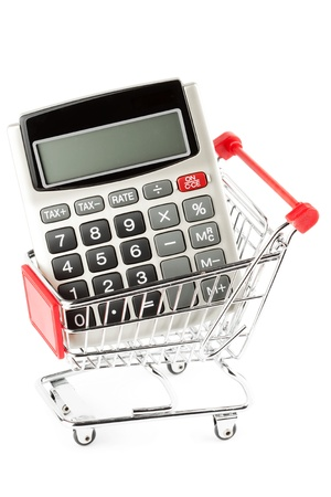 Financial concept of a calculator with a shopping trolley cart. photo