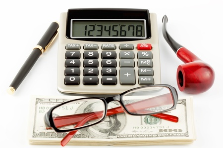 Financial Literacy. Closeup Pen, calculator, cash and glasses. photo