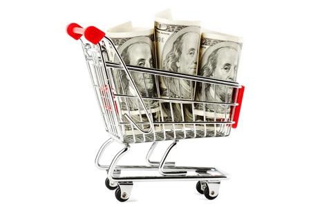 Kundvagn och dollar på den vita Stockfoto