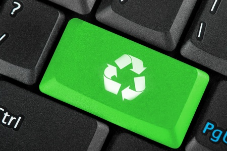Green recycle icon button on a keyboard photo