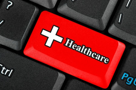 Red Healthcare icon button on a keyboard Stock Photo - 12459663