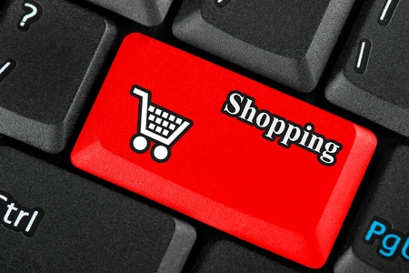 Red retail shopping cart icon button on a keyboard photo