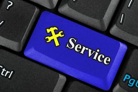 Closeup Blue service icon button on a keyboard photo