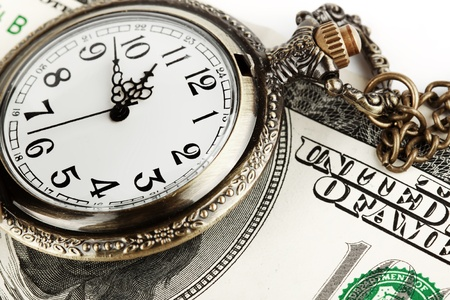 Time and money concept image. Pocket watch and US currency photo