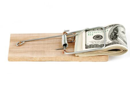 Many banknotes in mouse trap on the white background Stock Photo - 12459806