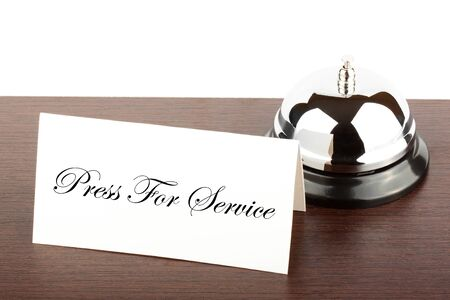 Service Bell with Press For Service Sign at Hotel Desk Stock Photo - 12459850