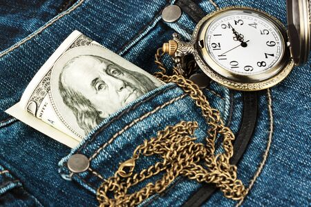 Closeup Money and watch in a jeans pocket photo