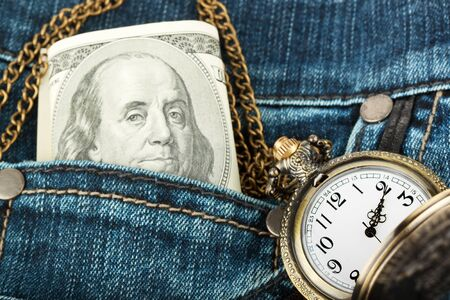 pochette: Closeup Money and watch in a jeans pocket Stock Photo