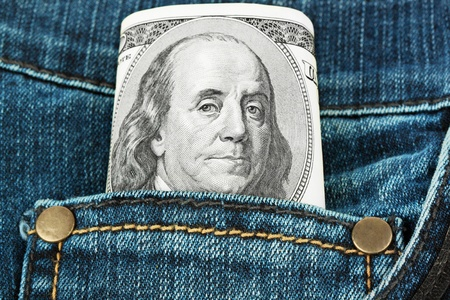 One hundred Dollars in a pocket of jeans photo
