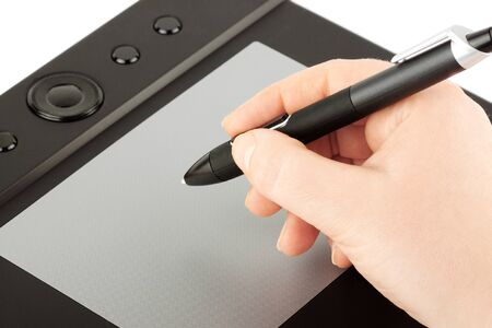 input device: Graphic tablet on the white background with hand and pen in it