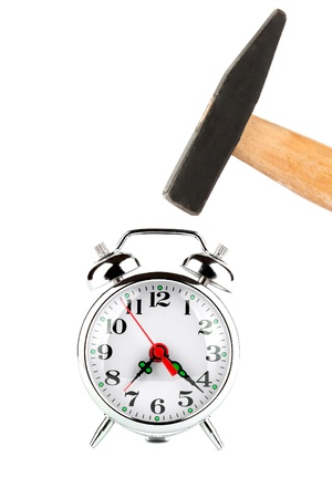 Time management - Hammer about to hit the alarm clock photo