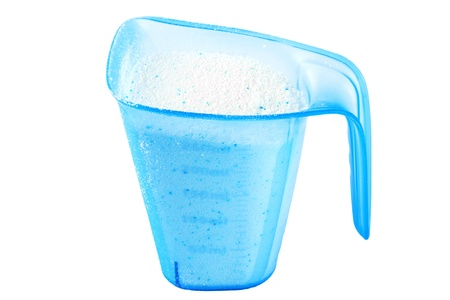 Close up White Detergent in blue cup on the white background photo